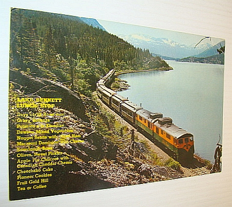 Image for Lake Bennett Lunch Stop: Picture Post Card (PPC) Colour Photo of a White Pass & Yukon Railway Train at Lake Bennett